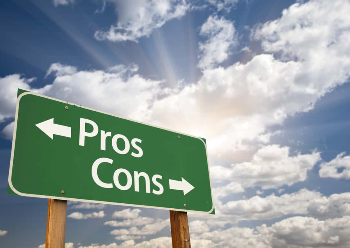 sign post stating direction of pros and cons